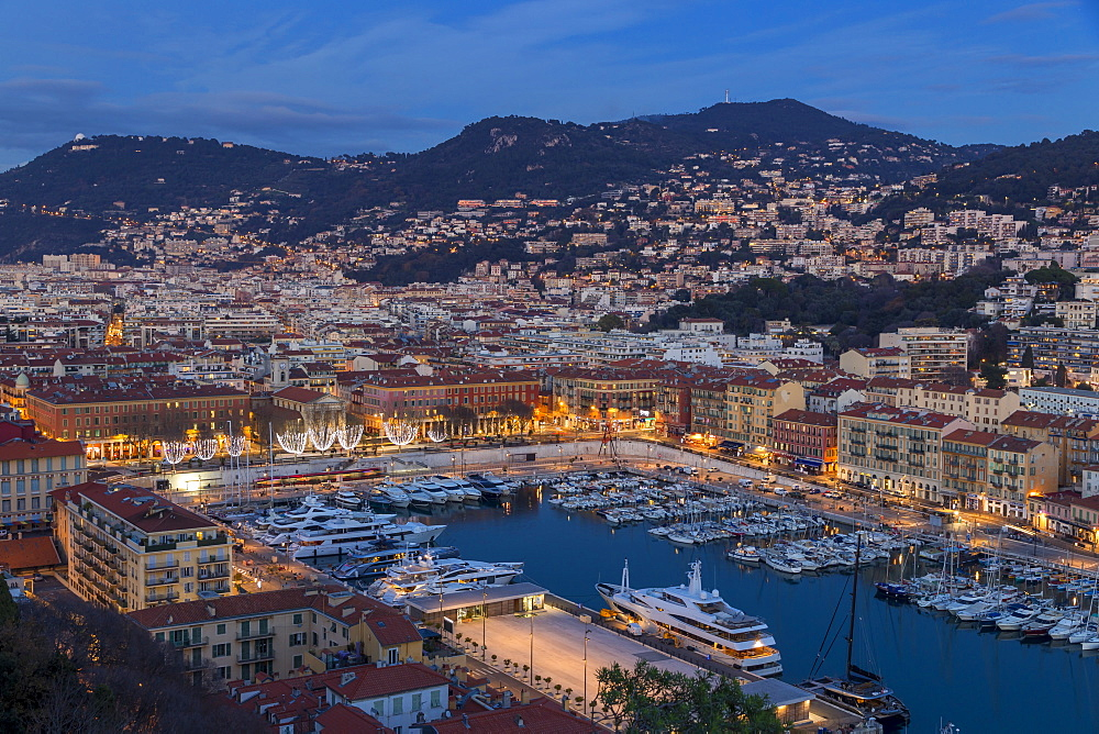Elevated view from Castle Hill down to Port Lympia at dusk, Nice, Cote d'Azur, French Riviera, France, Europe