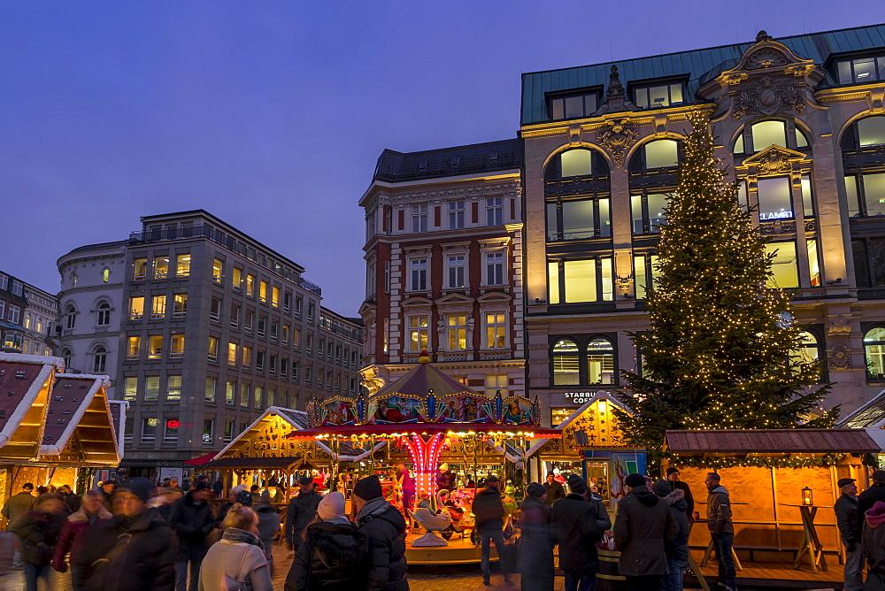 Christmas market at Gaensemarkt square in Hamburg at dusk