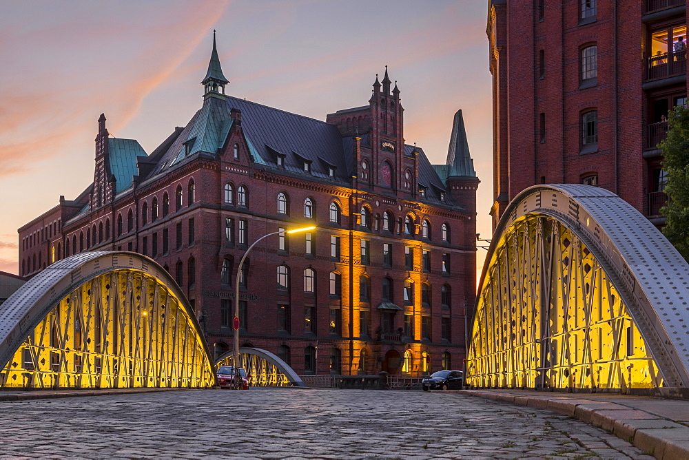 View from the Neuerwegsbruecke to the Sandtorkai-Hof building at the Speicherstadt (Warehouse complex) in Hamburg at sunset