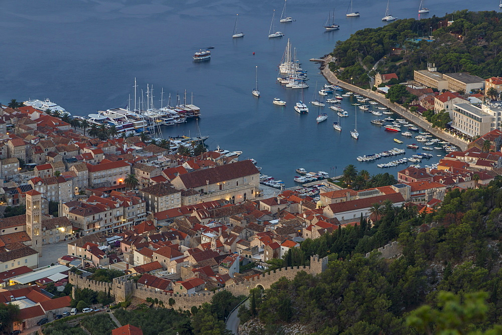 High-angle view over the port and the old town of Hvar Town at dawn