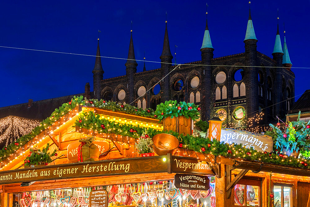 Christmas market at the town hall square of Luebeck at dusk