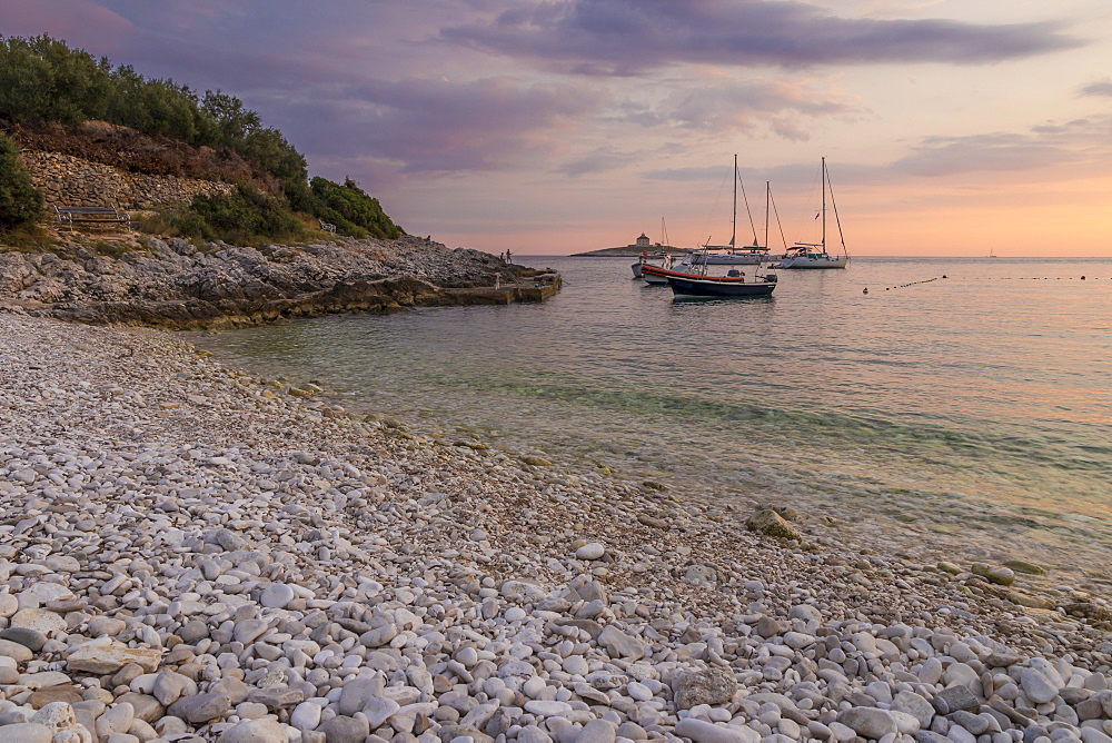 Boats anchoring at Pokonji Dol Beach near Hvar Town at sunset, Hvar, Croatia, Europe
