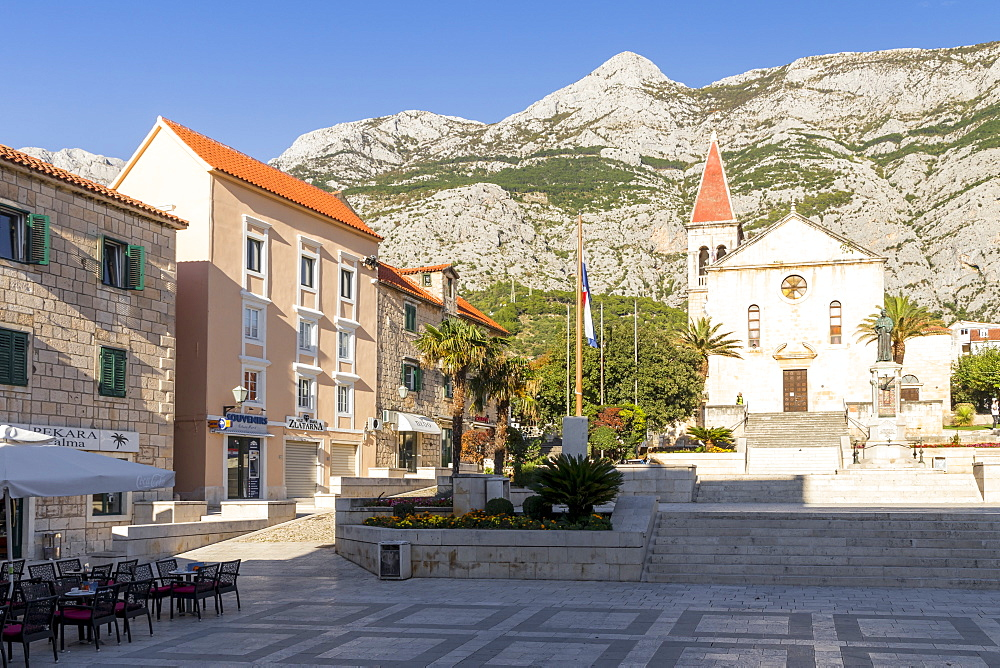 St. Mark's Church at the main square of Makarska with the Biokovo mountain range in the background