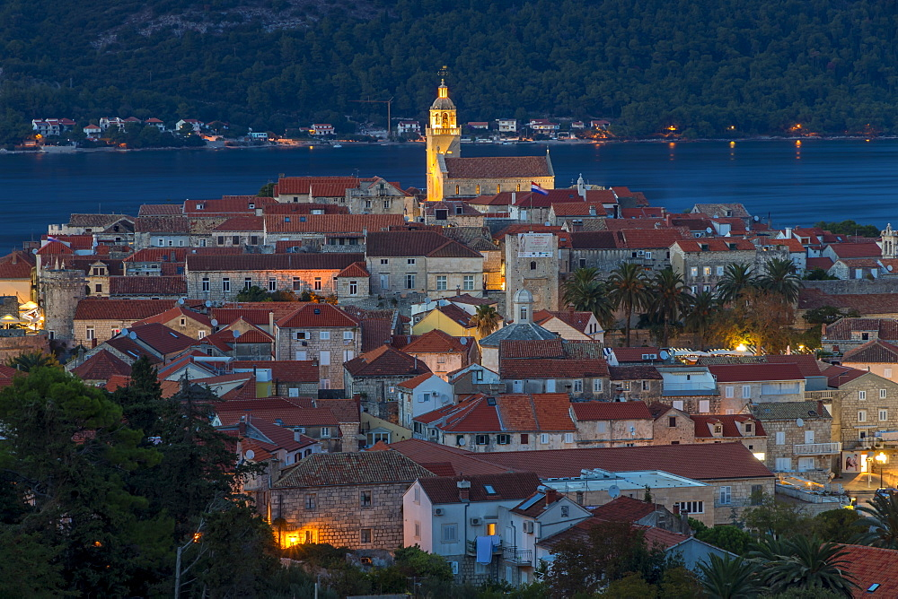 Elevated view over the old town of Korcula Town at dusk, Korcula, Croatia, Europe