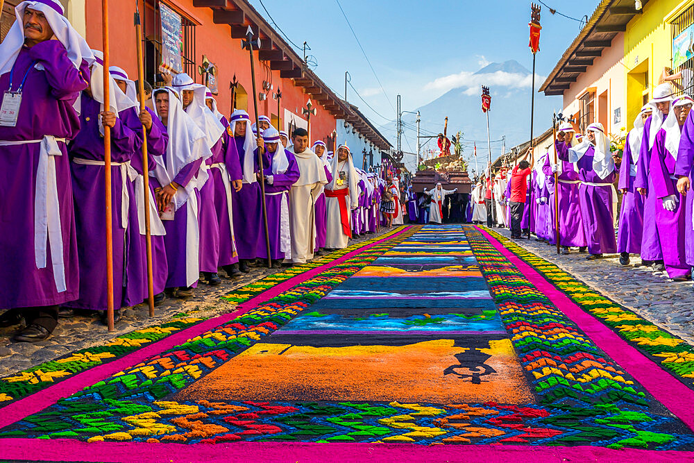 Good Friday procession approaching a sawdust carpet during Holy Week 2017 in Antigua