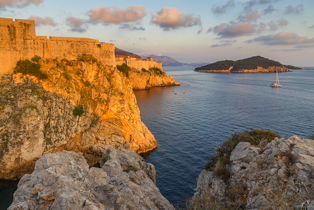 View to Lovrijenac Fortress, the city walls and Lokrum Island at sunset