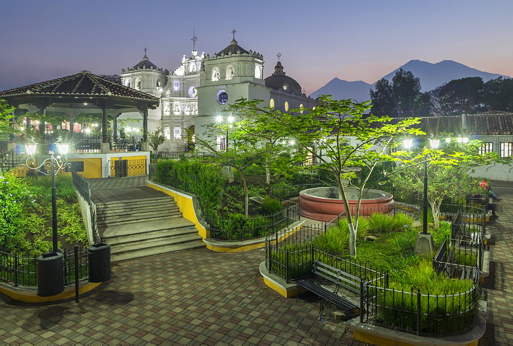 The cathedral and the main square of Ciudad Vieja with view to the volcanoes Fuego and Acatenango in the background
