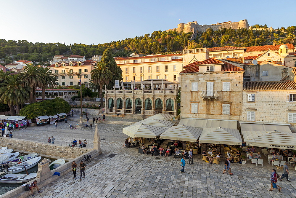 Elevated view over the main square (Trg Svetog Stjepana) and the Spanish Fortress in Hvar Town at first sunlight