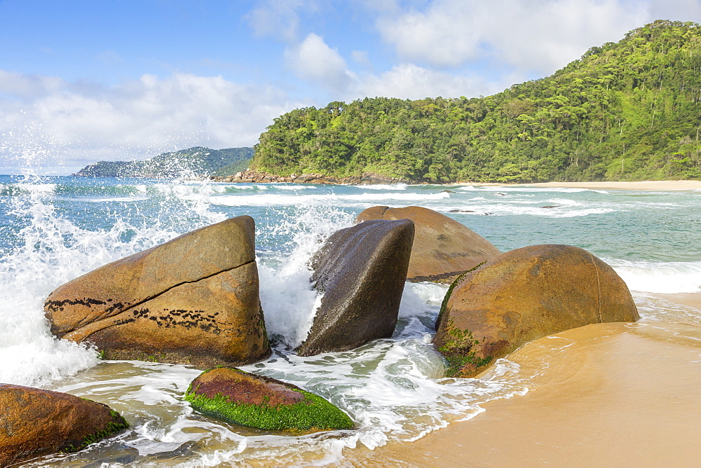 Waves splashing against rocks, Antigo Beach, Paraty (Parati), Rio de Janeiro, Brazil, South America