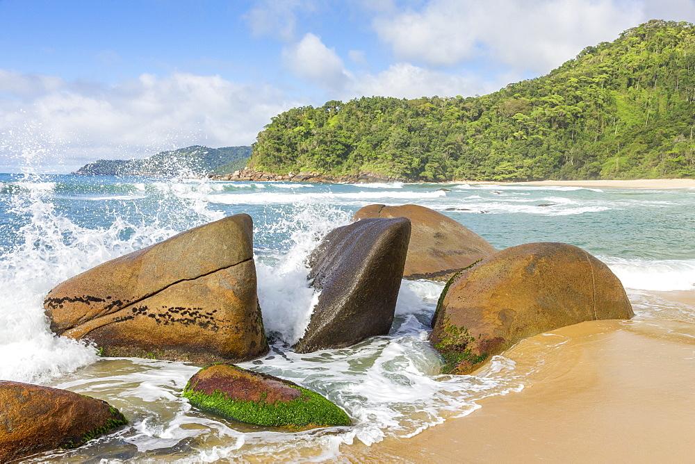 Waves splashing against some rocks, Antigo Beach, Paraty (Parati), Rio de Janeiro, Brazil