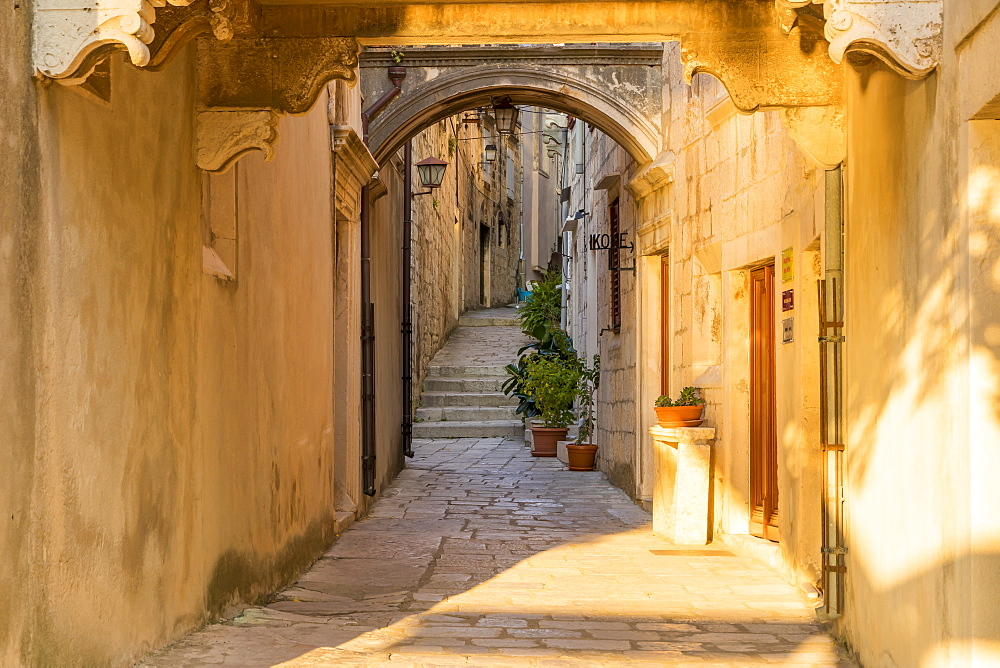 Narrow street inside the old town of Korcula at first sunlight, Korcula, Croatia, Europe