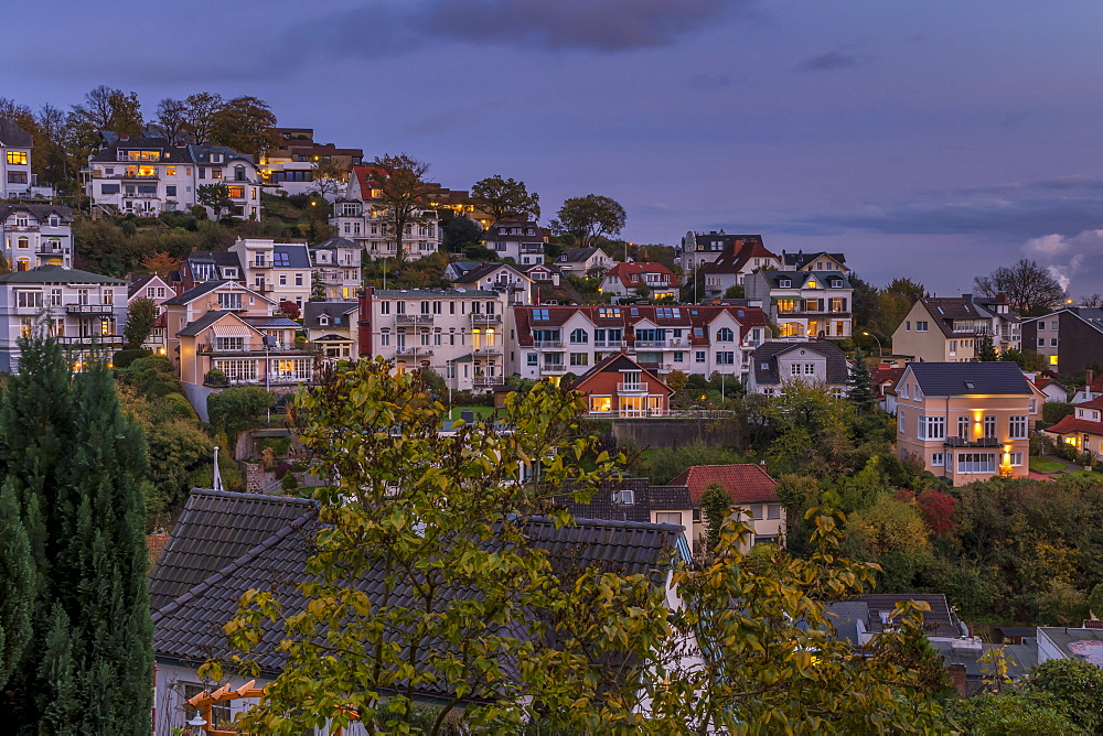 Elevated view over the mansions at the so called Treppenviertel, a quarter of the Blankenese district, at dusk, Hamburg, Germany, Europe