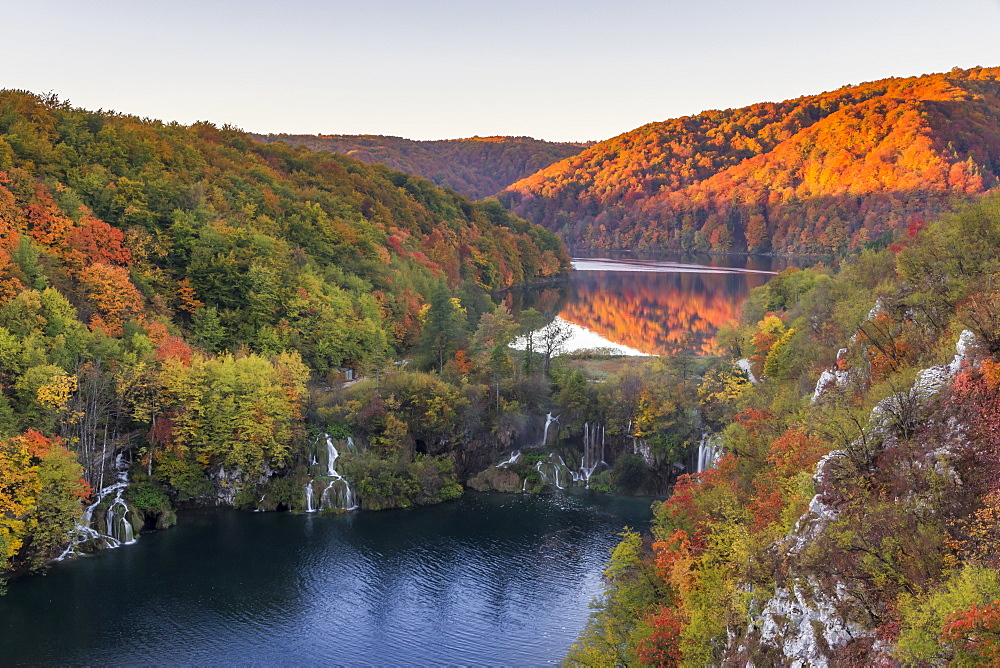 Elevated view over the Lower Lakes at sunrise inside Plitvice Lakes National Park during autumn