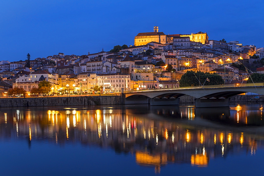 View from Mondego River to the old town with the university on top of the hill at dusk, Coimbra, Portugal, Europe