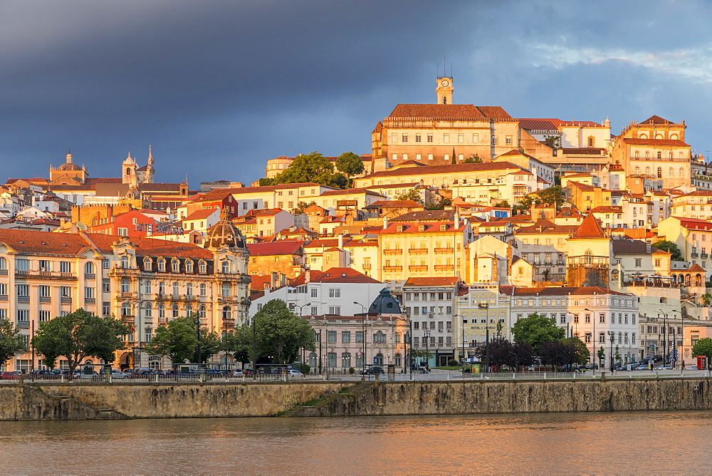 View from Mondego River to the old town with the university on top of the hill at sunset, Coimbra, Portugal, Europe