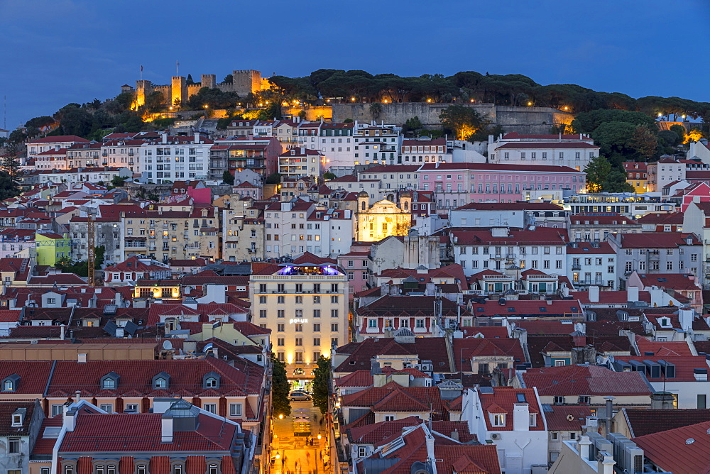 View from the Santa Justa Lookout over the city centre and the Sao Jorge Castle at dusk, Lisbon, Portgual, Europe