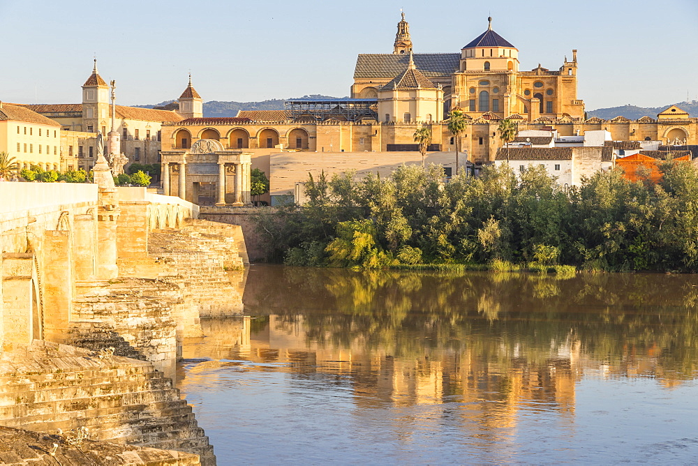 The Mosque-Cathedral (Great Mosque of Cordoba) (Mezquita) and Roman Bridge, UNESCO World Heritage Site, at first sunlight, Cordoba, Andalusia, Spain, Europe