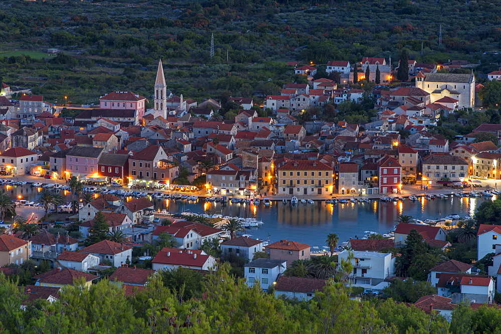 View from the lookout atop Glavica Hill over Stari Grad on Hvar Island at dusk, Hvar, Croatia, Europe