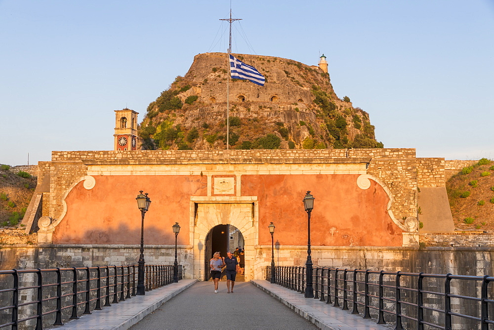 Entrance gate with the old fortress of Corfu Town (Kerkyra) in the background at sunset, Corfu, Greece, Europe