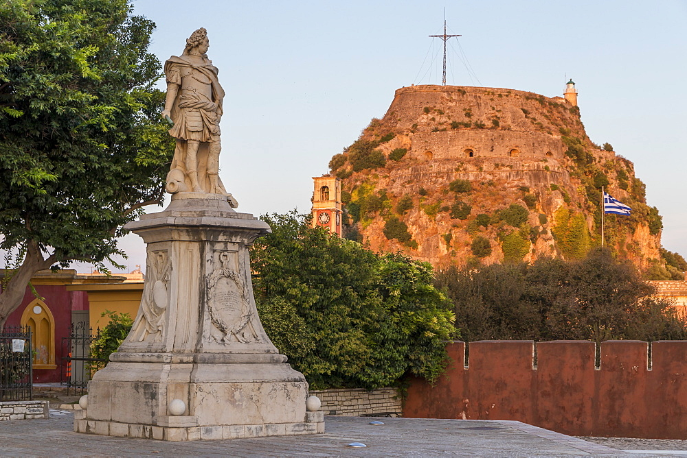 Statue of Count Schulenburg with the old fortress of Corfu Town (Kerkyra) in the background at sunset, Corfu, Greek Islands, Greece, Europe