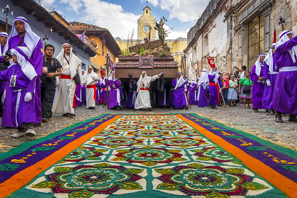 Good Friday Procession approaching a sawdust carpet during Holy Week 2017 in Antigua, Guatemala, Central America