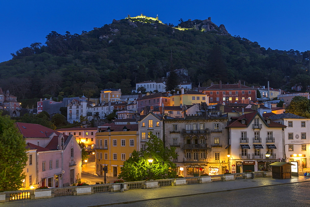 Old town of Sintra with view to the Moorish Castle atop the surrounding hills at dusk, Sintra, Portugal, Europe