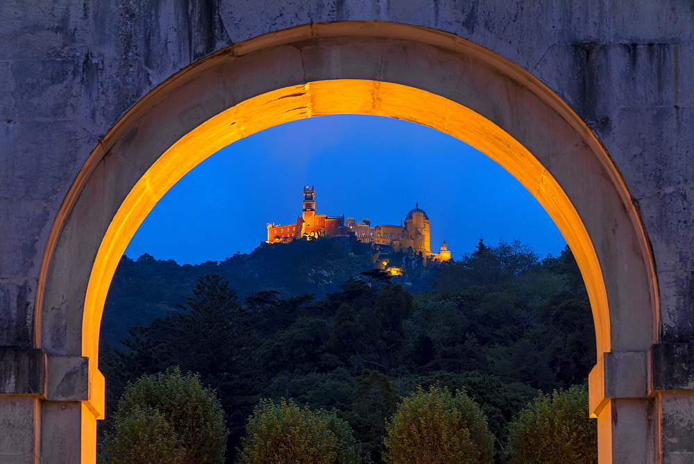 Illuminated Pena Palace seen from the Seteais Palace at dusk, UNESCO World Heritage Site, Sintra, Portugal, Europe - 1283-682