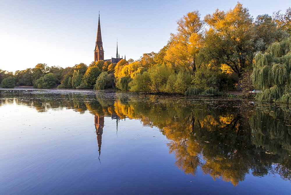 St. Gertrud Church at Kuhmuehlenteich in the Uhlenhorst district during autumn, Hamburg, Germany, Europe