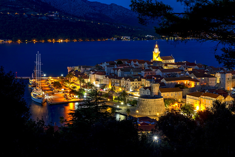 View from a lookout over Korcula Town at dusk, Korcula, Croatia, Europe