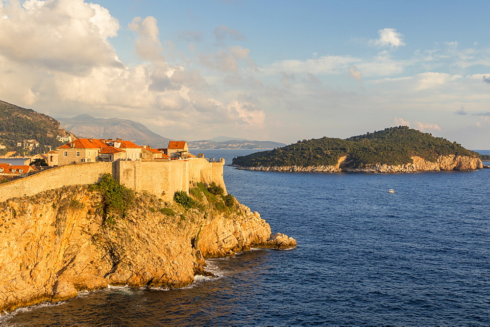 View to the city walls of Dubrovnik, UNESCO World Heritage Site, and Lokrum Island at sunset, Dubrovnik, Croatia, Europe