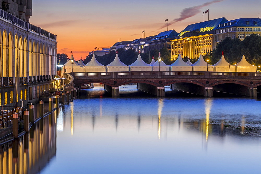 View from the town hall square to the Alsterarkaden, Reesendammbrücke and the Hapag Lloyd Building in Hamburg at dawn