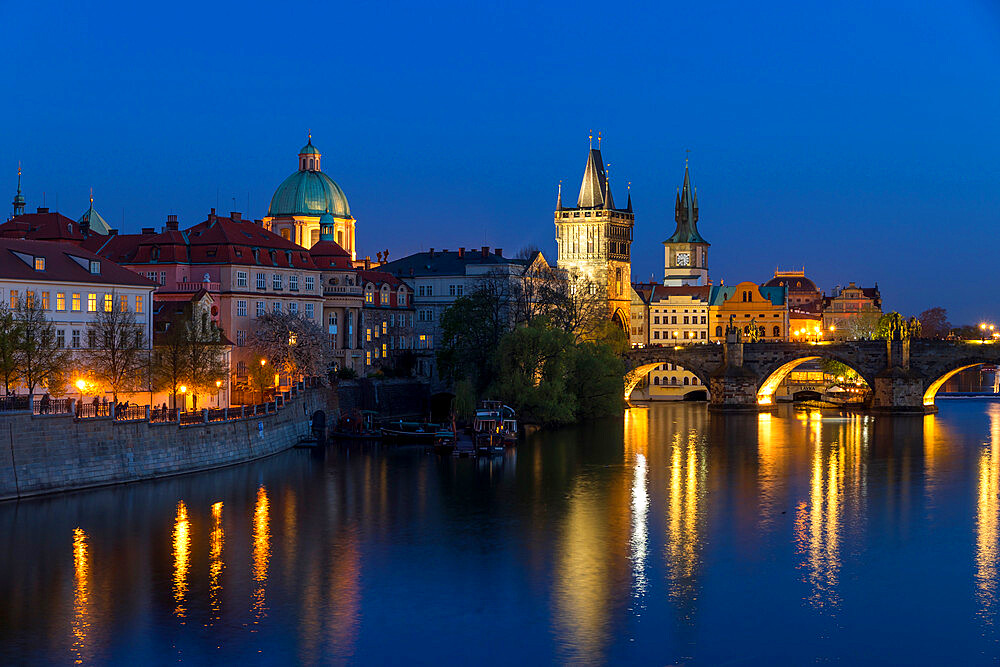 View over Charles Bridge, Old Town Bridge Tower and Vltava River at dusk, Prague, Bohemia, Czech Republic, Europe - 1283-831