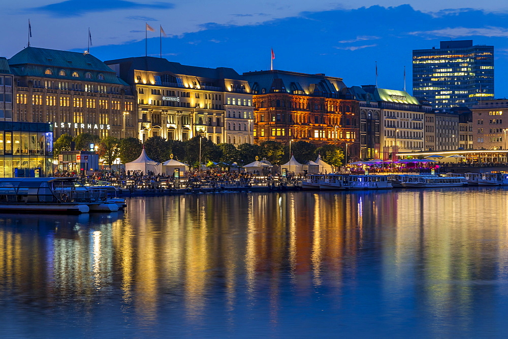 Illuminated buildings at Jungfernstieg and the Inner Alster at dusk