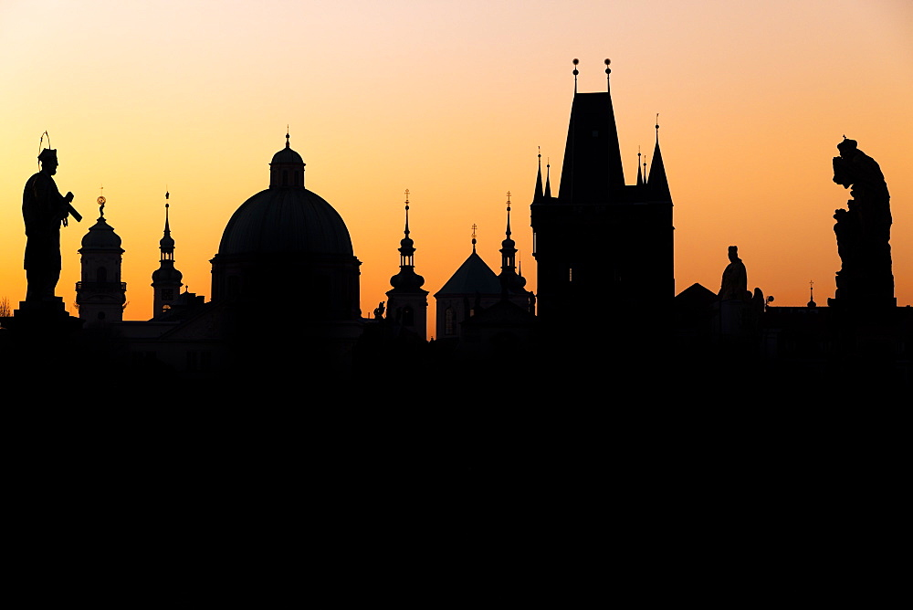 Silhouette of the old town buildings seen from Charles Bridge at sunrise, UNESCO World Heritage Site, Prague, Bohemia, Czech Republic, Europe