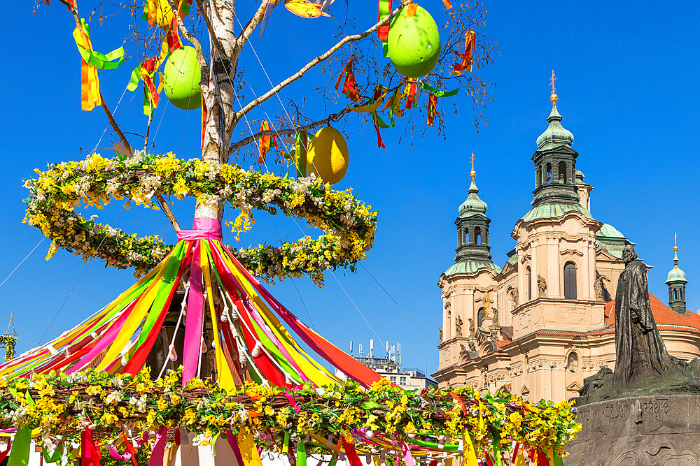 St. Nicholas' Church seen from the Easter Market at the old town market square, Prague, Bohemia, Czech Republic, Europe
