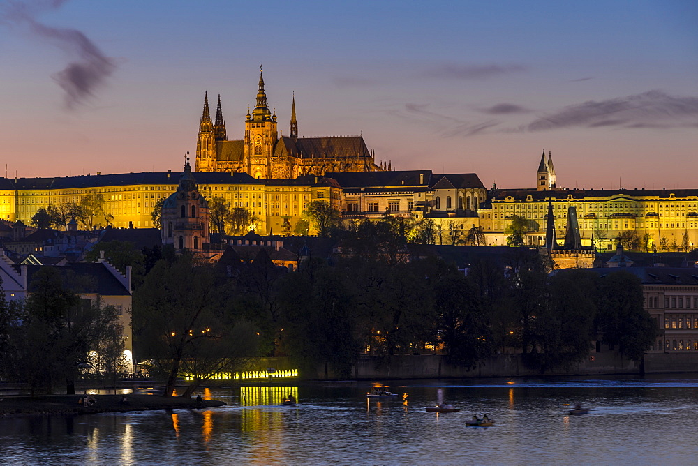 Illuminated Prague Castle and St. Vitus Cathedral seen from the banks of Vltava River, UNESCO World Heritage Site, Prague, Bohemia, Czech Republic, Europe