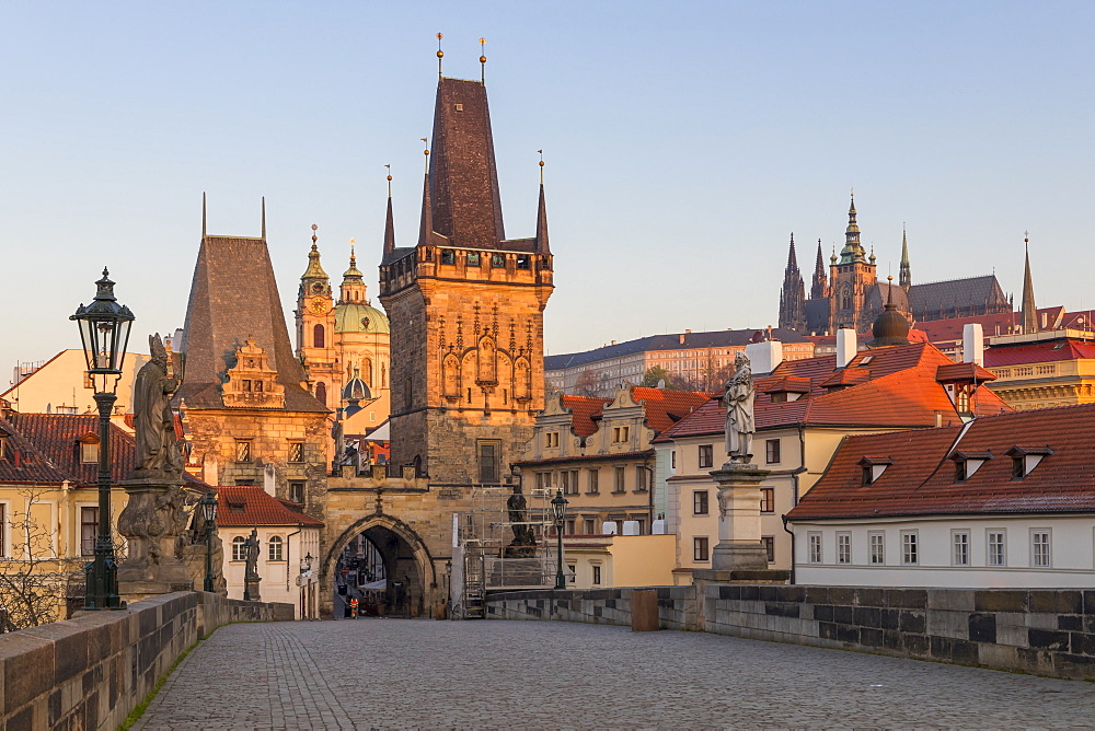 The Lesser Town Bridge Tower and St. Vitus Cathedral seen from Charles Bridge at first sunlight, Prague, Bohemia, Czech Republic - 1283-849