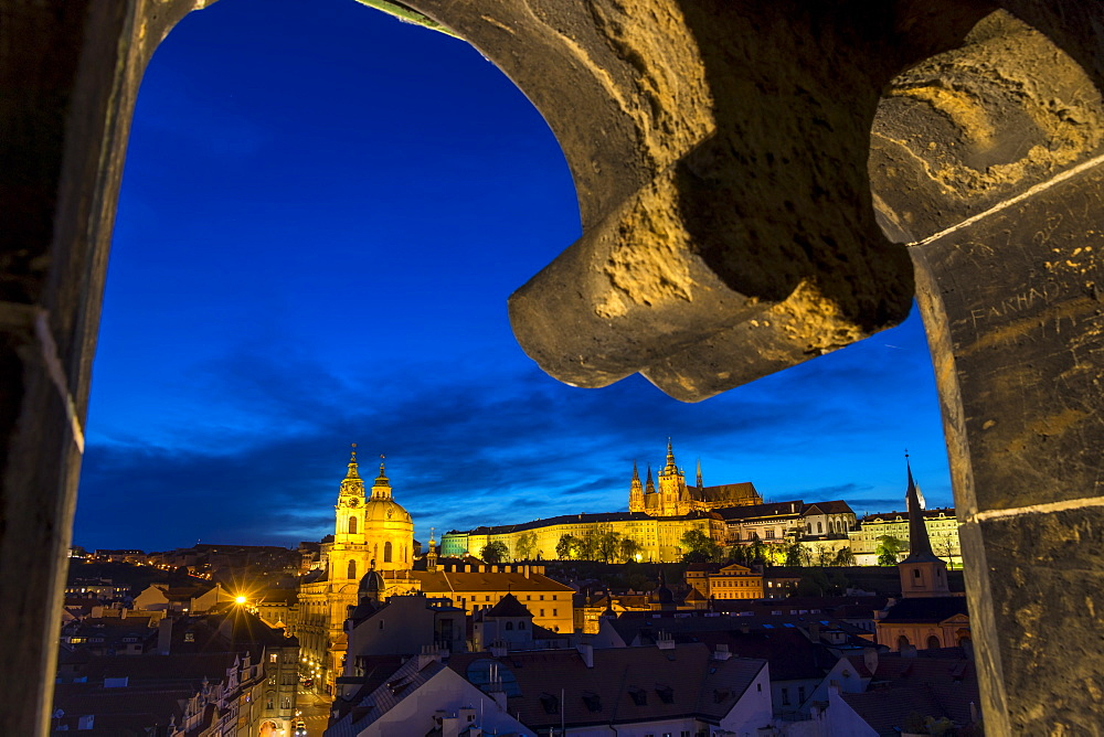View from the Lesser Town Bridge Tower to Prague Castle and St. Nicholas Church at dusk, UNESCO World Heritage Site, Prague, Bohemia, Czech Republic, Europe