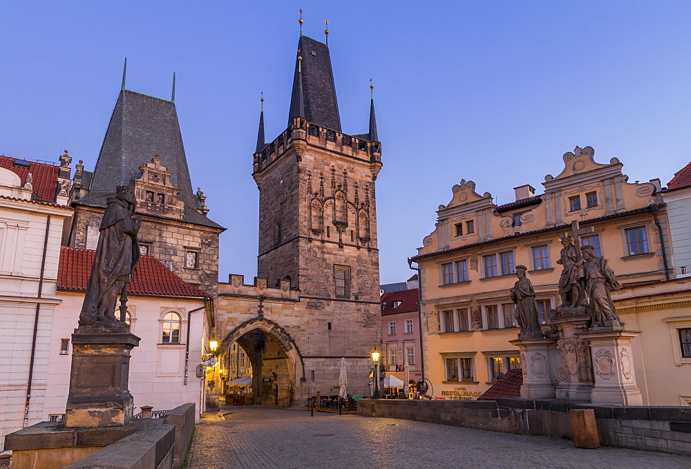 The Lesser Town Bridge Tower seen from Charles Bridge at dawn, UNESCO World Heritage Site, Prague, Bohemia, Czech Republic, Europe