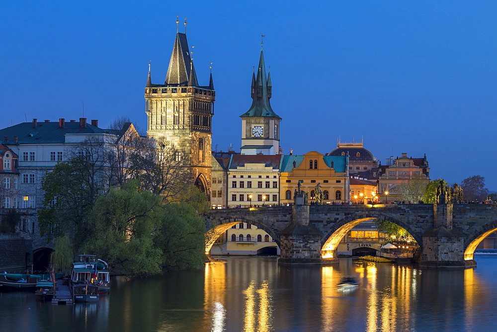 View over Charles Bridge, Old Town Bridge Tower and Vltava River at dusk, UNESCO World Heritage Site, Prague, Bohemia, Czech Republic, Europe