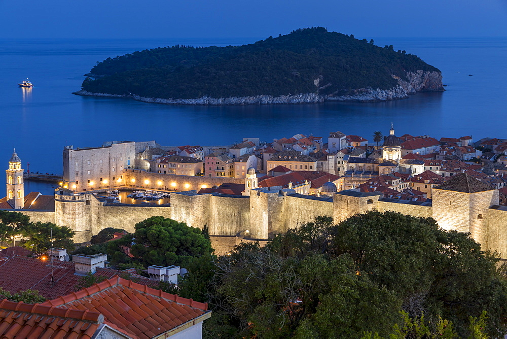 Elevated view from a lookout over the old town of Dubrovnik and Lokrum Island at dusk, Dubrovnik, Croatia, Europe