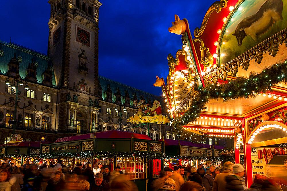 Christmas market at the town hall of Hamburg at dusk