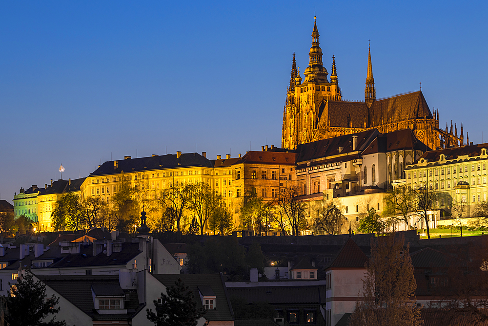 Illuminated Prague Castle and St. Vitus Cathedral at dusk, UNESCO World Heritage Site, Prague, Bohemia, Czech Republic, Europe