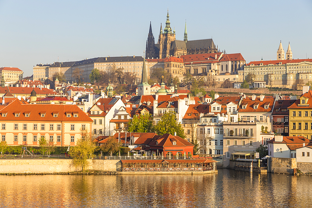 View from the banks of Vltava River over the Mala Strana district, Prague Castle and St. Vitus Cathedral, UNESCO World Heritage Site, Prague, Czech Republic, Europe