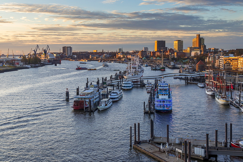 Elevated view from the Elbphilharmonie building over the port of Hamburg at sunset