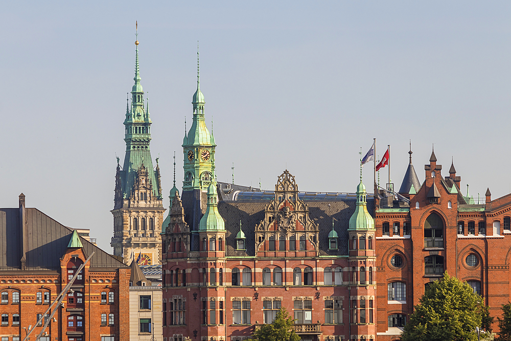 Historical buildings in the Speicherstadt (UNESCO World Heritage Site) with the town hall in the background, Hamburg, Germany