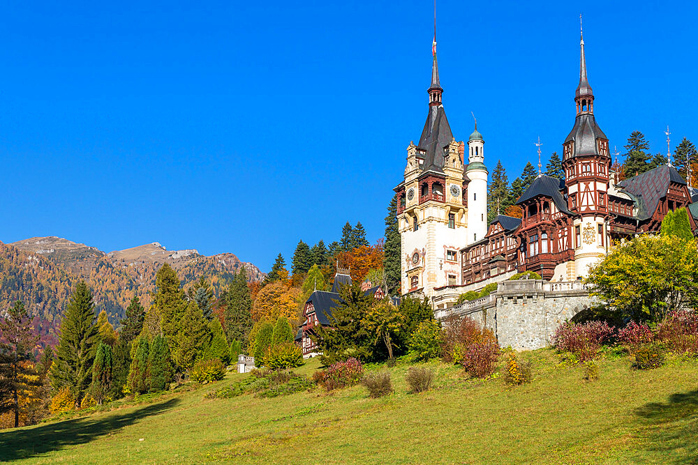 Peles Castle in the Bucegi Mountains Natural Park during autumn, Sinaia, Romania, Europe