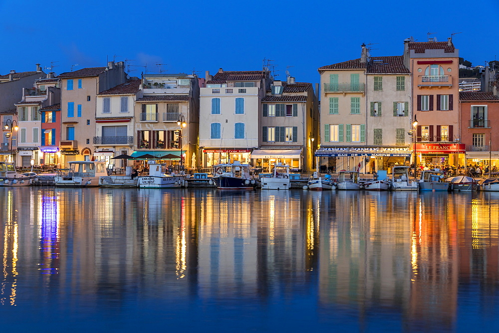View from the port to the old town at dusk, Cassis, France, Europe
