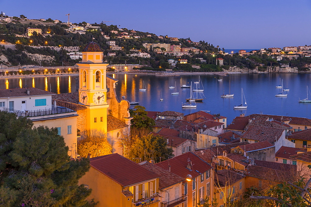 Illuminated Saint-Michel Church at dusk, Villefranche sur Mer, Alpes Maritimes, Cote d'Azur, French Riviera, France, Europe