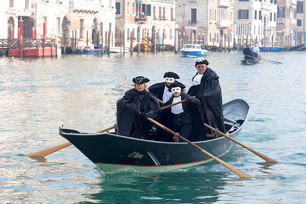 People in Venice Carnival costumes, rowing gondola on Grand Canal, Venice, UNESCO World Heritage Site, Veneto, Italy, Europe